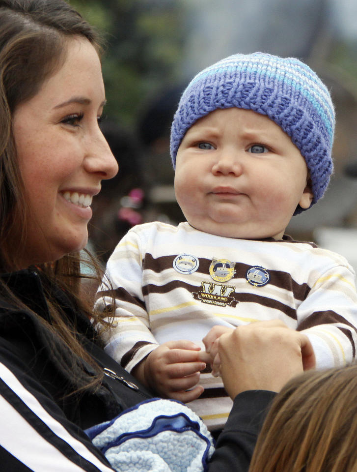 In this July 25, 2009, photo, former Alaska Gov. Sarah Palin's daughter Bristol Palin holds her and Levi Johnston's son Tripp Johnston at the governor's picnic in Anchorage, Alaska. Tax documents show unwed mother Bristol Palin earned more than $262,000 for her role helping raise awareness for teen pregnancy prevention in 2009. The most recent data for The Candie's Foundation that's posted online by research firm GuideStar shows compensation at $262,500 for the now-20-year-old daughter of former Alaska Gov. Sarah Palin, the 2008 Republican vice presidential nominee.