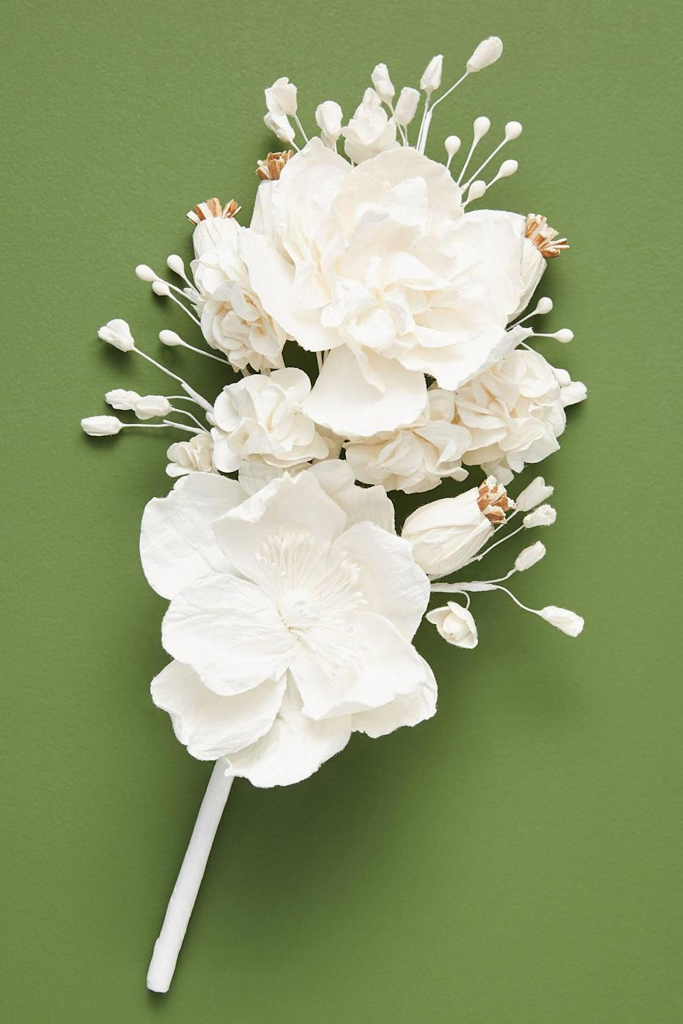 """<p>Create the ultimate centerpiece with this <a href=""""https://www.popsugar.com/buy/Mulberry-Paper-Flower-Stem-490451?p_name=Mulberry%20Paper%20Flower%20Stem&retailer=anthropologie.com&pid=490451&price=24&evar1=casa%3Aus&evar9=46615300&evar98=https%3A%2F%2Fwww.popsugar.com%2Fhome%2Fphoto-gallery%2F46615300%2Fimage%2F46615321%2FMulberry-Paper-Flower-Stem&list1=shopping%2Canthropologie%2Choliday%2Cchristmas%2Cchristmas%20decorations%2Choliday%20decor%2Chome%20shopping&prop13=mobile&pdata=1"""" rel=""""nofollow noopener"""" class=""""link rapid-noclick-resp"""" target=""""_blank"""" data-ylk=""""slk:Mulberry Paper Flower Stem"""">Mulberry Paper Flower Stem</a> ($24).</p>"""