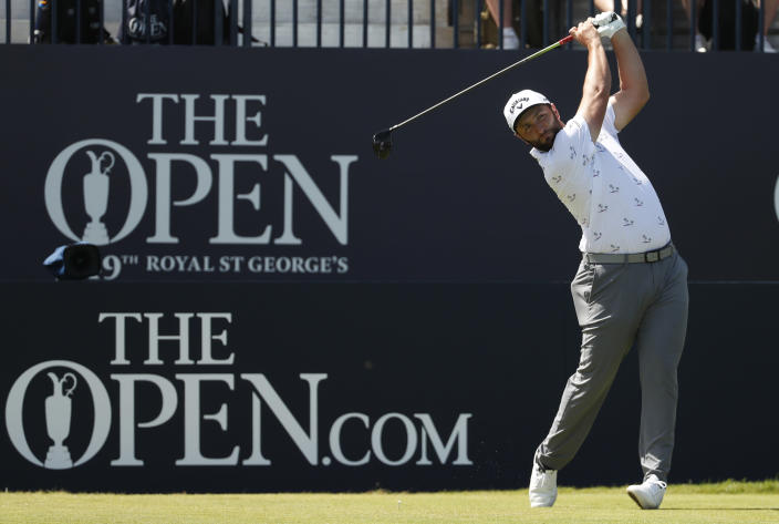 Spain's Jon Rahm play his shot from the 1st tee during the third round of the British Open Golf Championship at Royal St George's golf course Sandwich, England, Saturday, July 17, 2021. (AP Photo/Peter Morrison)