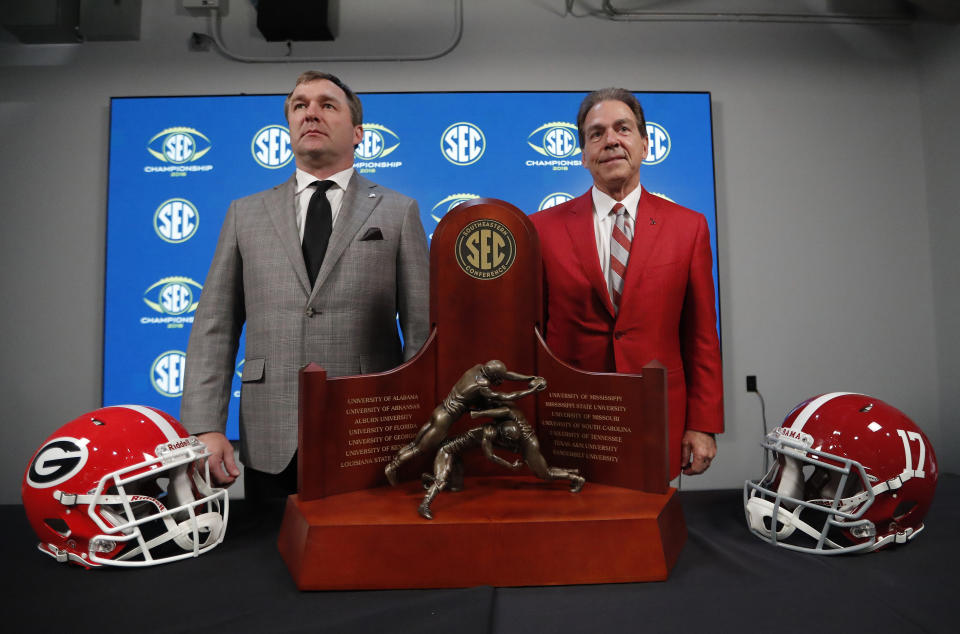 Georgia coach Kirby Smart (L) and Alabama coach Nick Saban pose near the SEC trophy on Nov. 30, 2018. (AP)
