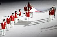 <p>Japan's flag was carried on stage by a group that included one healthcare worker.</p>