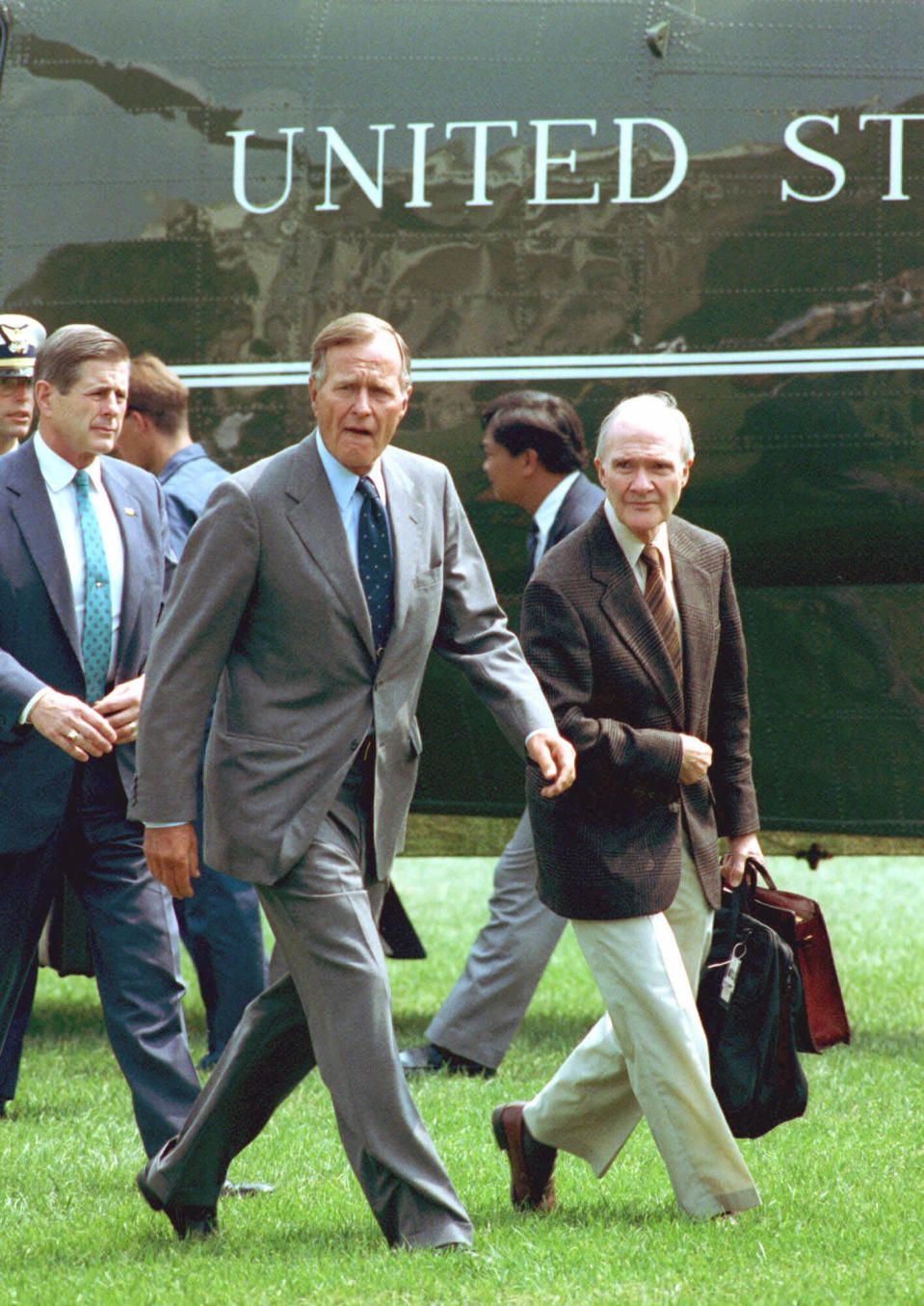 FILE - In this August 19, 1991 file photo, President George Bush, accompanied by National Security Adviser Brent Scowcroft, right, arrives back at the White House after he interrupteed his vacation following the overthrow of Soviet President Gorbachev. A longtime adviser to Presidents Gerald Ford and George H.W. Bush has died. Brent Scowcroft was 95. A spokesperson for the late President Bush says Scowcroft died Thursday of natural causes at his home in Falls Church, Virginia. (AP Photo/Barry Thumma)