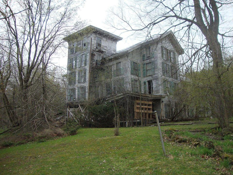 """<p><strong>Hyde Manor - Sudbury, VT</strong></p><p>What was once a grand resort marking Victorian-era design, is now completely dilapidated and mostly overrun by nature. The former hotel looks like it's straight out of a horror movie.</p><p>Photo: Wikimedia Commons/<a href=""""https://en.wikipedia.org/wiki/Hyde%27s_Hotel#/media/File:HydeManor.jpg"""" rel=""""nofollow noopener"""" target=""""_blank"""" data-ylk=""""slk:826 Paranormal"""" class=""""link rapid-noclick-resp"""">826 Paranormal</a></p>"""