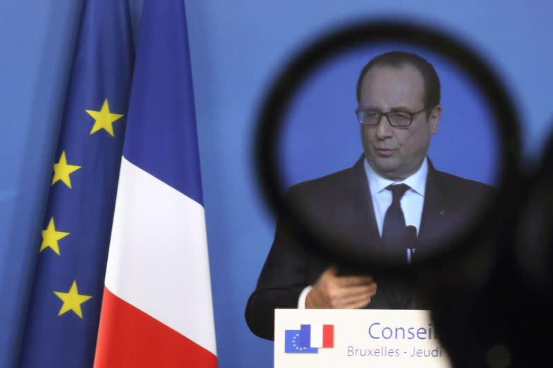 France's President Francois Hollande is seen through a camera filter during a news conference at a European Union leaders summit in Brussels December 18, 2014.REUTERS/Pascal Rossignol