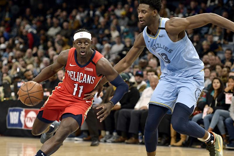 Holiday returns to lead Pelicans past Grizzlies