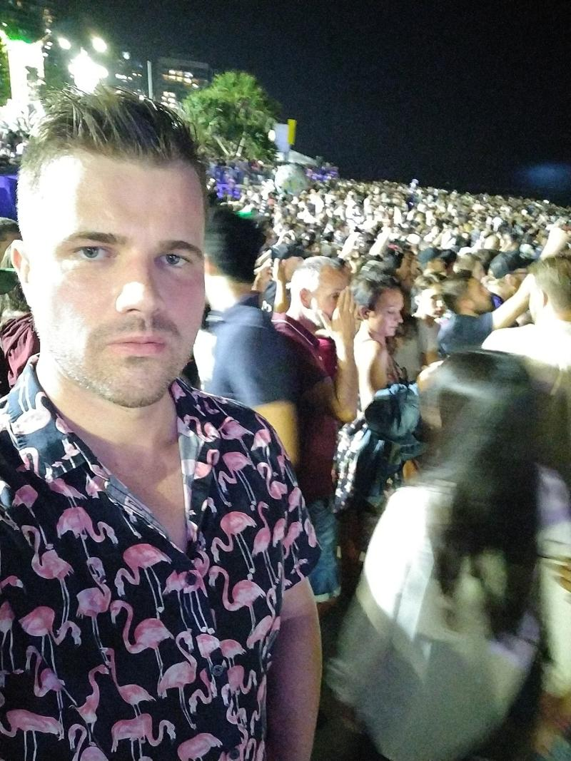 Gable Tostee takes a selfie among a crowd of people at night time. The photo was posted on New Year's Day.