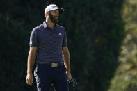 Dustin Johnson reacts to his missed putt on the fourth green during the final round of the Masters golf tournament Sunday, Nov. 15, 2020, in Augusta, Ga. (AP Photo/Charlie Riedel)