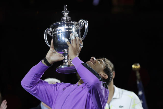 Rafael Nadal, of Spain, holds up the trophy after defeating Daniil Medvedev, of Russia, to win the men's singles final of the U.S. Open tennis championships Sunday, Sept. 8, 2019, in New York. (AP Photo/Adam Hunger)