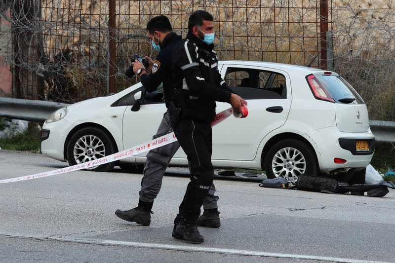 Israeli security forces cordon off an area at the scene of what Israeli police said was an attempted car-ramming attack at a checkpoint in East Jerusalem