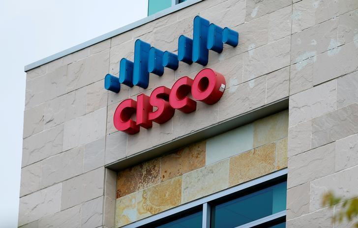 FILE PHOTO - The logo of Dow Jones Industrial Average stock market index listed company Cisco is seen in San Diego California