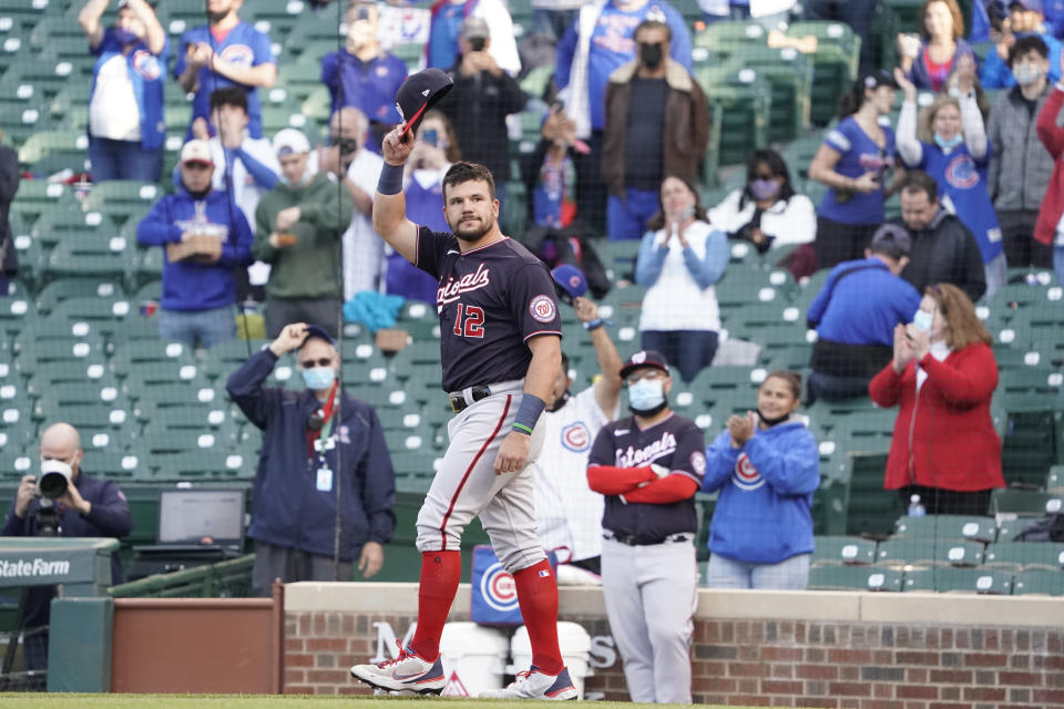 Washington Nationals left fielder Kyle Schwarber (12) tips his cap as the former Cub is honored before a baseball game against the Chicago Cubs, Monday, May, 17, 2021, in Chicago. (AP Photo/David Banks)