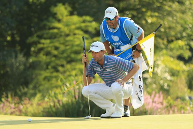 "<a class=""link rapid-noclick-resp"" href=""/pga/players/8478/"" data-ylk=""slk:Webb Simpson"">Webb Simpson</a> was being bothered by a heckler for several holes in the third round of the Dell Technologies Championship on Sunday. Finally, on the last hole, his caddie let the fan have it. (Getty Images)"