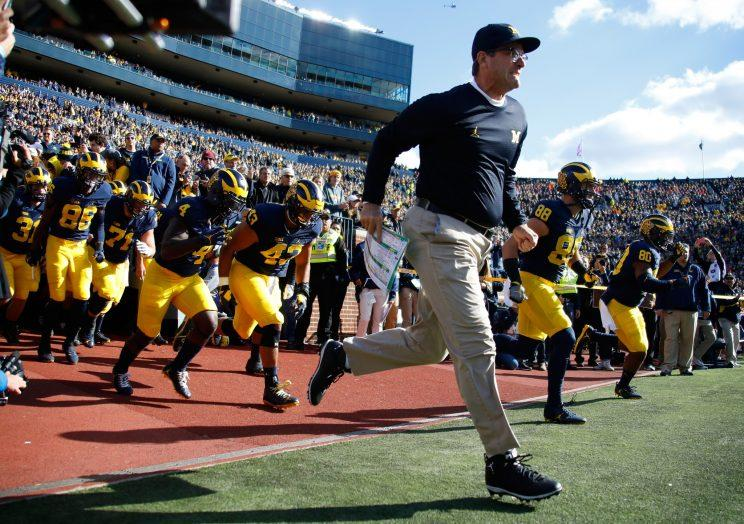 Would the proposed recruiting rules changes help Jim Harbaugh and Michigan? (Getty)