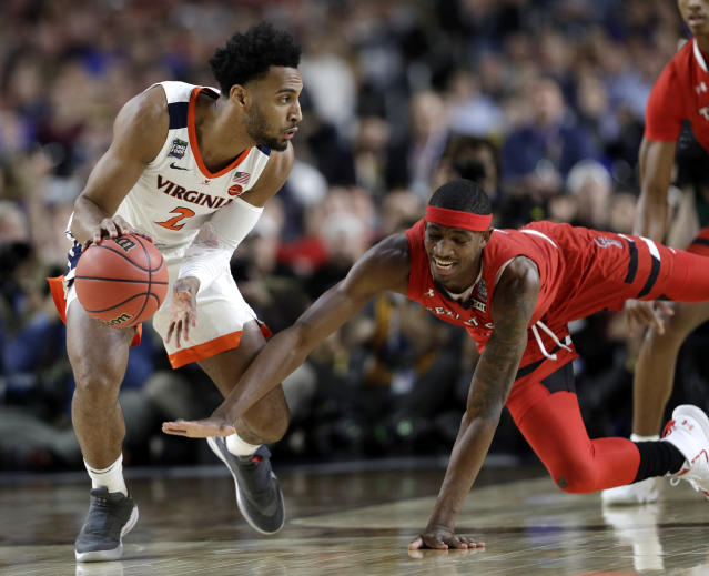 Virginia guard Braxton Key fights for a loose ball with Texas Tech forward Tariq Owens, right, during the first half in the championship game of the Final Four NCAA college basketball tournament, Monday, April 8, 2019, in Minneapolis. (AP Photo/David J. Phillip)