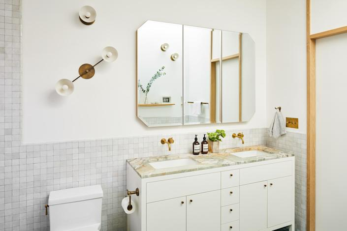 The Moroccan zellige tiles are from Mosaic House. The plumbing fixtures are unlacquered brass by Vola. The octagonal medicine cabinet was custom designed by the architects.