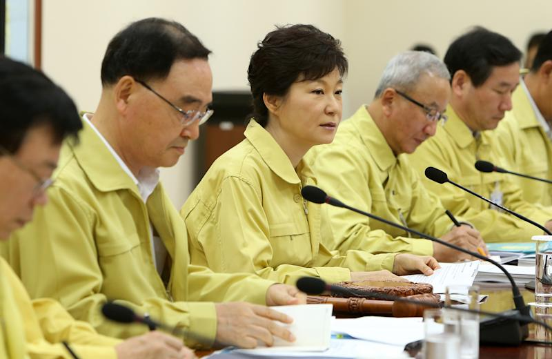 South Korean President Park Geun-hye, center, presides over a cabinet meeting at the presidential house in Seoul, South Korea, Monday, Aug. 19, 2013. The meeting was designed to ensure complete government-wide preparation in national emergency situations, as part of the Ulchi Freedom Guardian, an annual joint-military exercise by South Korea and the United States. (AP Photo/Yonhap) KOREA OUT