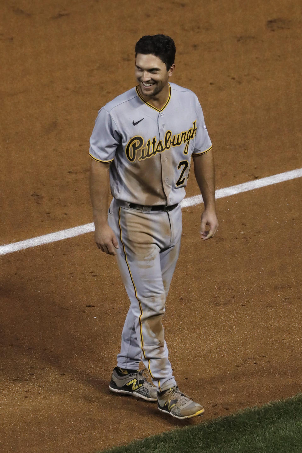 Pittsburgh Pirates' Adam Frazier smiles as he walks to the dugout during the third inning of the team's baseball game against the Chicago Cubs in Chicago, Saturday, Aug. 1, 2020. (AP Photo/Nam Y. Huh)