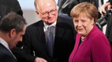 German cars pose no security risk to United States, Merkel says