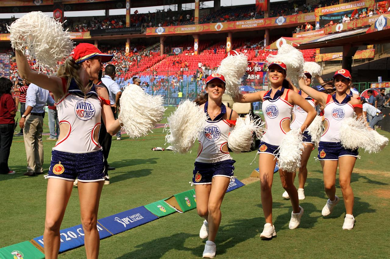 RCB's cheer leaders enters during match 9 of of the Pepsi Indian Premier League between The Royal Challengers Bangalore and The Sunrisers Hyderabad held at the M. Chinnaswamy Stadium, Bengaluru on the 9th April 2013. (BCCI)