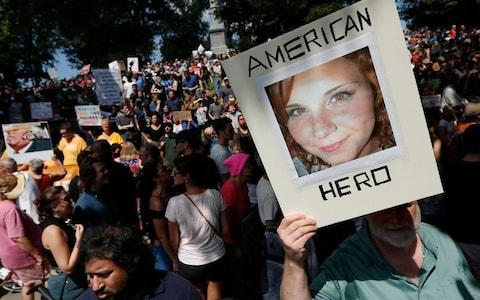 "A counterprotester holds a photo of Heather Heyer on Boston Common at a ""Free Speech"" rally  - Credit: AP"