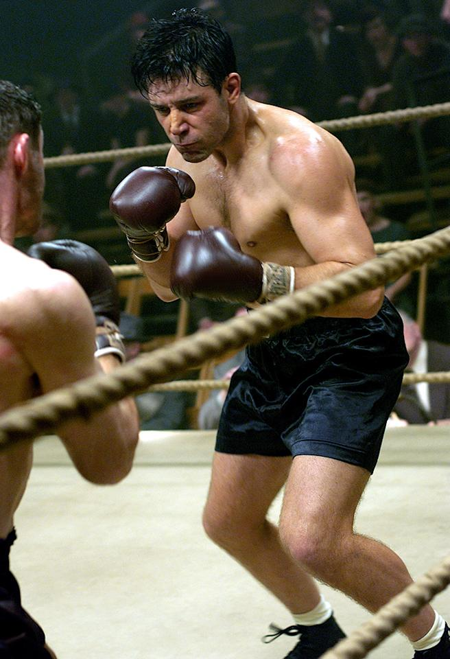 "<b>Russell Crowe: ""Cinderella Man""</b><br />To get star Russell Crowe into ""fighting shape"" for his role as Depression-era boxing champ James J. Braddock for the 2005 flick ""Cinderella Man,"" director Ron Howard recruited legendary trainer Angelo Dundee (83 at the time!), who flew to Crowe's native Australia to spend a month with him. In addition to the boxing training, Crowe biked, swam, and ran on a daily basis under the trainer's tutelage. Dundee, who passed away last year at the age of 90, told <a href=""http://sportsillustrated.cnn.com/vault/article/magazine/MAG1104020"" target=""_blank"">Sports Illustrated</a> in 2005 that during the three months the movie was shooting in Canada, then-40-year-old Crowe would work out for an hour each day before coming to the set and sparred on the side with a Canadian amateur boxer. ""If I'd had Russell when he was a kid,"" Dundee said, ""I coulda' made a real fighter out of him."" If only!"