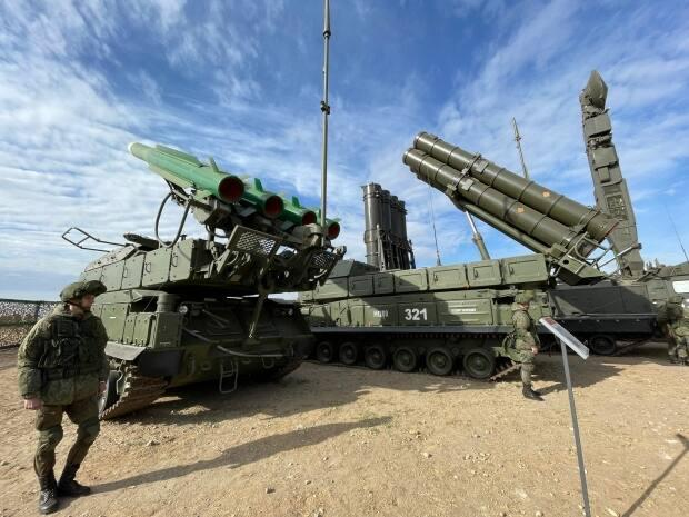 A Russian soldier stands beside a Buk missile system at the Donguz training range in southeast Russia last week.  (Briar Stewart/CBC - image credit)