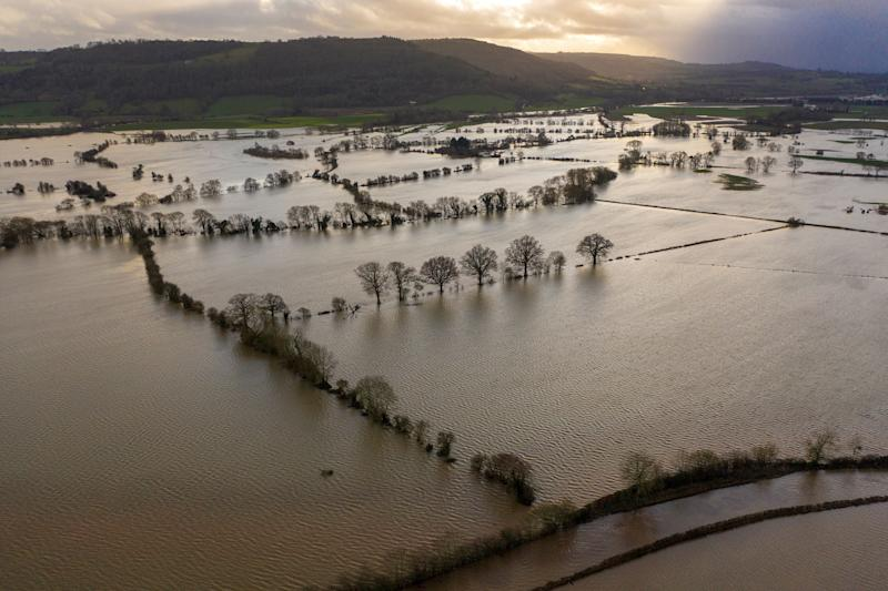 Floodwater covers fields in the Wye Valley in Hereford, England (Photo: Christopher Furlong via Getty Images)