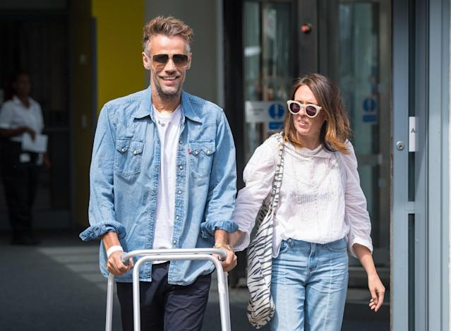 Richard Bacon with his wife Rebecca leaving hospital after his collapse last year (Credit: PA)