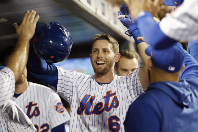 New York Mets' Jeff McNeil (6) is congratulated in the dugout after hitting a solo home run during the second inning of the team's baseball game against the Arizona Diamondbacks, Wednesday, Sept. 11, 2019, in New York. (AP Photo/Kathy Willens)