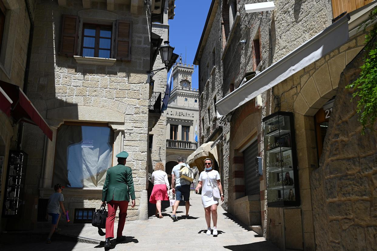 People walk, as the Republic of San Marino starts a campaign inviting tourists to get vaccinated with the Russia's Sputnik V COVID-19 vaccine, June 1, 2021. Picture taken June 1, 2021. REUTERS/Alberto Lingria