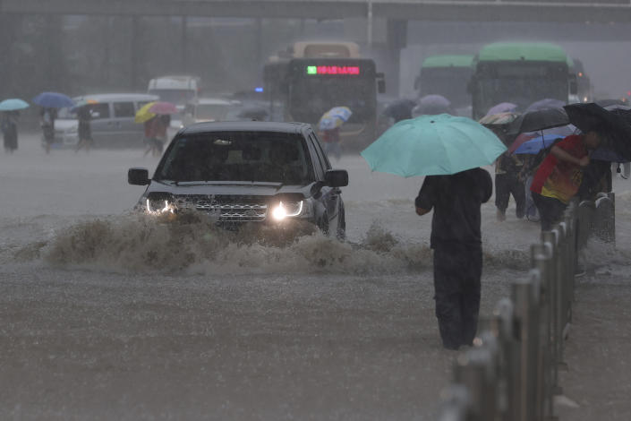 Heavy downpour in Zhengzhou city, central China's Henan province on Tuesday, July 20, 2021. Heavy flooding has hit central China following unusually heavy rains, with the subway system in the city of Zhengzhou inundated with rushing water. (Chinatopix Via AP)