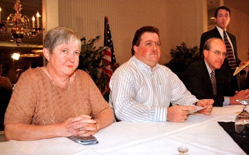 ATLANTA, GA - OCTOBER 28: Richard Jewell (C) his mother Barbara (L) and attorneys Watson Bryant (R) and Wayne Grant (far R) look on during a press conference 28 October in Atlanta, Ga. Jewell was cleared as a suspect in the July 27 bombing of Centennial Olympic Park. (Photo credit should read DOUG COLLIER/AFP/Getty Images)