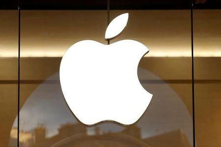 The Apple logo is seen on the facade of the new Apple Store in Paris