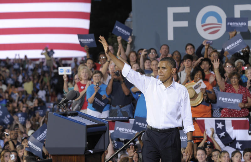President Barack Obama waves to the crowd after speaking at a campaign event outside Roanoke Fire Station #1 in Roanoke, Va., Friday, July 13, 2012. Obama is spending the day campaigning in Virginia. (AP Photo/Susan Walsh)