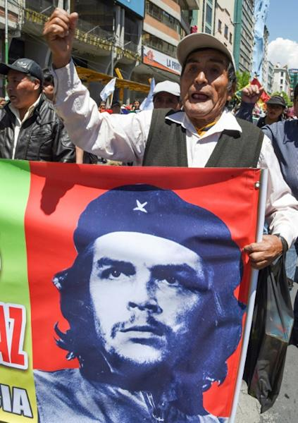 A supporter of Bolivian ex-President Evo Morales holds banner with an image of revolutionary leader Ernesto 'Che' Guevara during a demonstration Monday in La Paz