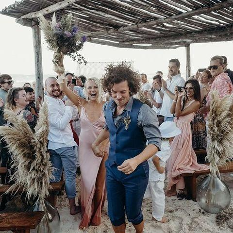 "<p>Malin wore a bohemian <a href=""https://www.cosmopolitan.com/uk/fashion/celebrity/a25390118/malin-akerman-wedding-dress/"" rel=""nofollow noopener"" target=""_blank"" data-ylk=""slk:pink slip dress by Cushnie"" class=""link rapid-noclick-resp"">pink slip dress by Cushnie</a> for her beach wedding in Tulum to British actor Jack Donnelly, telling Vogue she loves the brand for making her feel 'chic and cool'.</p><p><a href=""https://www.instagram.com/p/Bq7hCHqBmFj/"" rel=""nofollow noopener"" target=""_blank"" data-ylk=""slk:See the original post on Instagram"" class=""link rapid-noclick-resp"">See the original post on Instagram</a></p>"