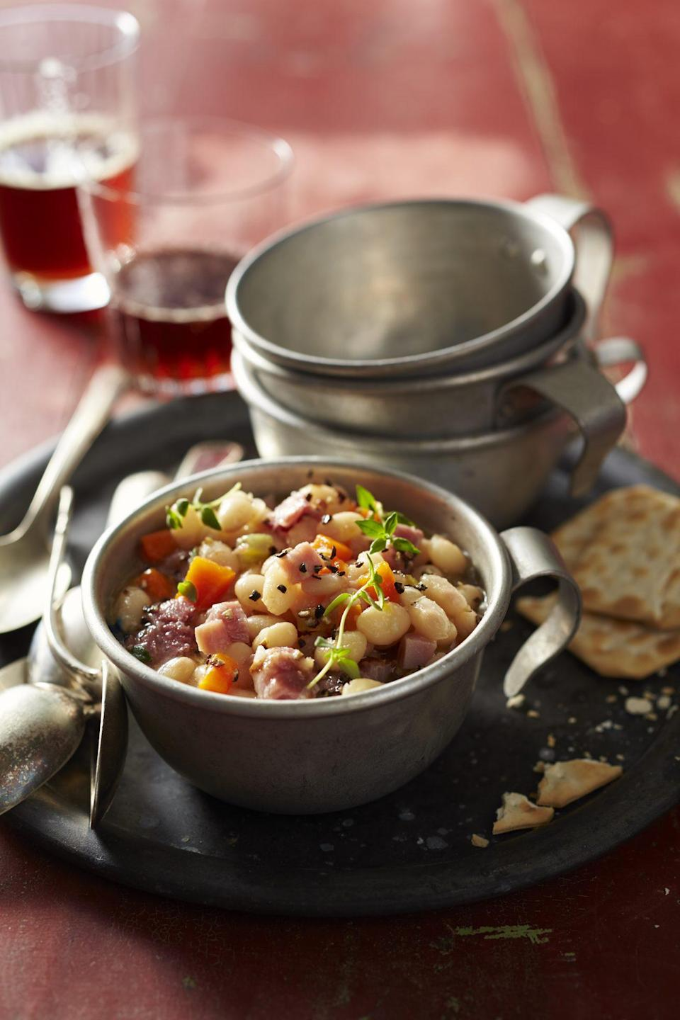 """<p><strong>Recipe: <a href=""""https://www.southernliving.com/recipes/navy-bean-and-ham-soup-recipe"""" rel=""""nofollow noopener"""" target=""""_blank"""" data-ylk=""""slk:Navy Bean and Ham Soup"""" class=""""link rapid-noclick-resp"""">Navy Bean and Ham Soup</a></strong></p> <p>You'll know this slow cooker soup is done cooking when the beans are tender. Before serving, we like garnishing each bowl with fresh thyme and serving with crusty bread or crackers. </p>"""