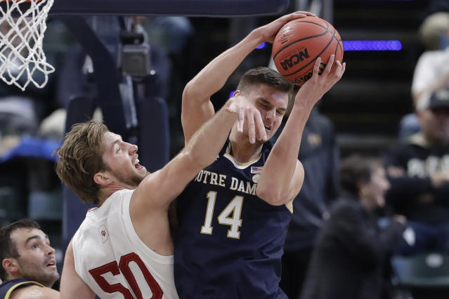 Notre Dame's Nate Laszewski (14) grabs a rebound from Indiana's Joey Brunk (50) during the first half of an NCAA college basketball game, Saturday, Dec. 21, 2019. (AP Photo/Darron Cummings)
