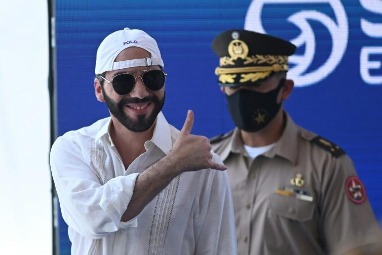 El Salvador's President Nayib Bukele (L) said that in a bid to boost its wide adoption, each citizen who opens an electronic bitcoin 'wallet' named Chivo will have $30's worth uploaded to their account