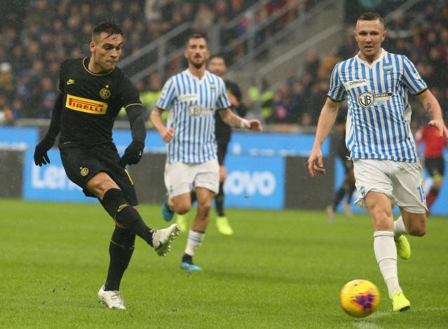 Inter Milan's Lautaro Martinez scores his side's first goal during the Italian serie A soccer match between Inter and Spal at the Giuseppe Meazza stadium in Milan, Italy, Sunday, Dec. 1, 2019. (Matteo Bazzi/ANSA via AP)