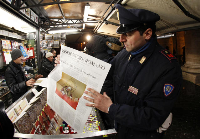 "A policeman hold the Osservatore Romano newspaper in Rome February 11, 2013. Pope Benedict shocked the world on Monday by saying he no longer had the mental and physical strength to cope with his ministry, in an announcement that left his aides ""incredulous"" and will make him the first pontiff to step down since the Middle Ages. He will step down on February 28 and the Vatican expects a new Pope to be chosen by the end of March. REUTERS/Giampiero Sposito (ITALY - Tags: RELIGION) - RTR3DN7U"