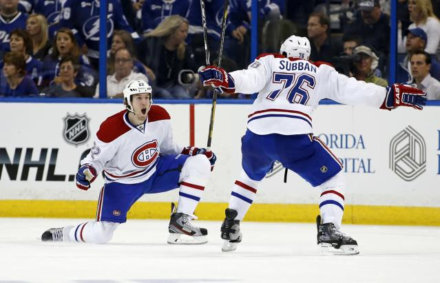 TAMPA, FL - APRIL 16: Dale Weise #22 of the Montreal Canadiens celebrates his game-winning goal in overtime with P.K. Subban #76 against the Tampa Bay Lightning in Game One of the First Round of the 2014 Stanley Cup Playoffs at the Tampa Bay Times Forum on April 16, 2014 in Tampa, Florida. (Photo by Mike Carlson/Getty Images)