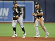 Chicago White Sox outfielders John Jay, left, and Leury Garcia, right, smile as they jog off the field after a win over the Tampa Bay Rays in a baseball game Friday, July 19, 2019, in St. Petersburg, Fla. (AP Photo/Steve Nesius)