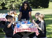 U.S. first lady Michelle Obama talks to local elementary school students after picking vegetables with them during the annual fall harvest of the White House Kitchen Garden at the White House in Washington, October 6, 2015. REUTERS/Joshua Roberts/File Photo