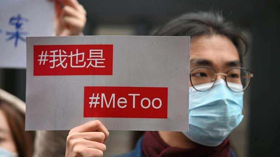 Supporters of Zhou Xiaoxuan, a feminist figure who rose to prominence during Chinas #MeToo movement two years ago, display posters outside the Haidian District Peoples Court in Beijing on December 2, 2020, in a sexual harassment case against one of China's best-known television hosts.