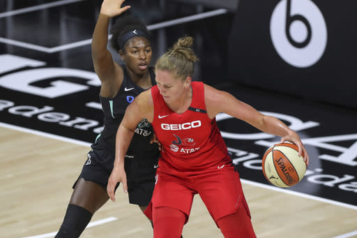 Washington Mystics' Emma Meesseman backs into the defense of New York Liberty's Jocelyn Willoughby during the first half of a WNBA basketball game Saturday, Sept. 12, 2020, in Bradenton, Fla. (AP Photo/Mike Carlson)