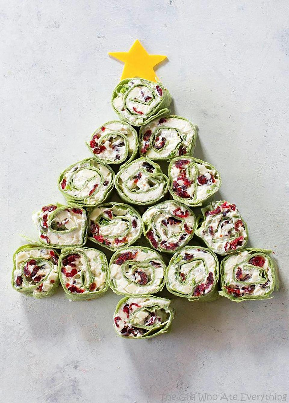 """<p>These easy pinwheels only require five ingredients. Bonus points if you display them in the shape of a tree!</p><p><strong>Get the recipe at <a href=""""http://www.the-girl-who-ate-everything.com/2015/11/cranberry-and-feta-pinwheels.html"""" rel=""""nofollow noopener"""" target=""""_blank"""" data-ylk=""""slk:The Girl Who Ate Everything"""" class=""""link rapid-noclick-resp"""">The Girl Who Ate Everything</a>.</strong></p>"""