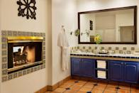 <p>Yep, that's a fireplace in the bathroom because why the heck not. </p>