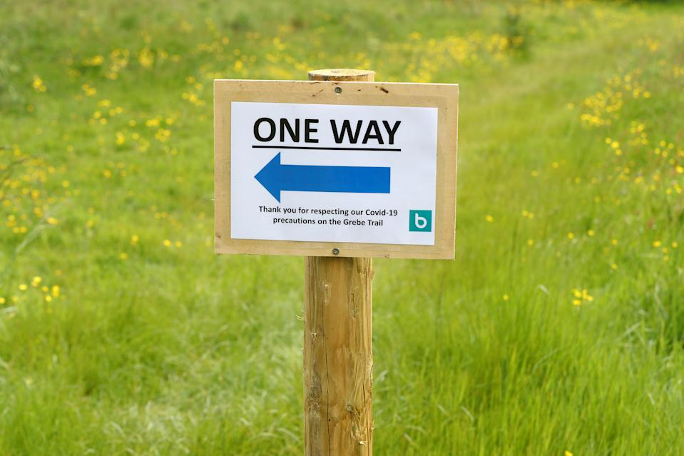 CHEW MAGNA,  - MAY 13: One way signs on the Grebe Trail on May 13, 2020 in Chew Valley Lake, Somerset, England. The prime minister announced the general contours of a phased exit from the current lockdown, adopted nearly two months ago in an effort curb the spread of Covid-19. (Photo by Michael Steele/Getty Images)