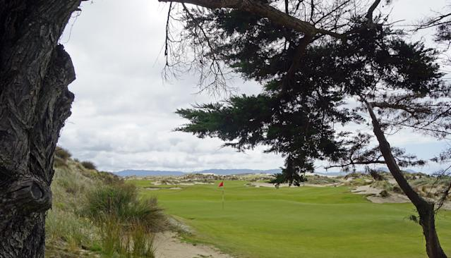 "<div class=""caption""> A look at the seventh green while walking up to the eighth tee </div>"